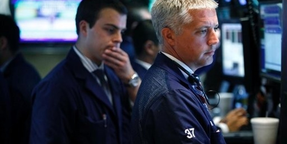 Traders work on the floor at the New York Stock Exchange in New York, Monday, Aug. 3, 2009.  (AP Photo/Seth Wenig)