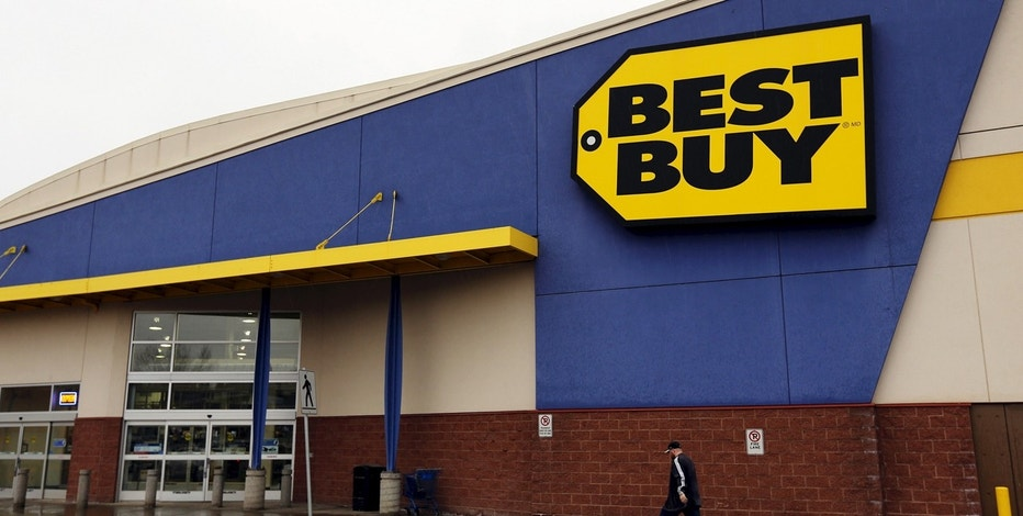 A man walks to a Best Buy store