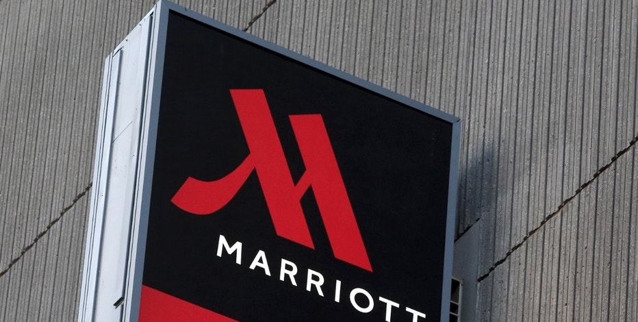 Signage for the New York Marriott Marquis is seen in Manhattan, New York, November 16, 2015. Marriott International Inc will buy Starwood Hotels & Resorts Worldwide Inc for $12.2 billion to create the world's largest hotel chain with top brands including Sheraton, Ritz Carlton and the Autograph Collection.  REUTERS/Andrew Kelly - RTS7E72