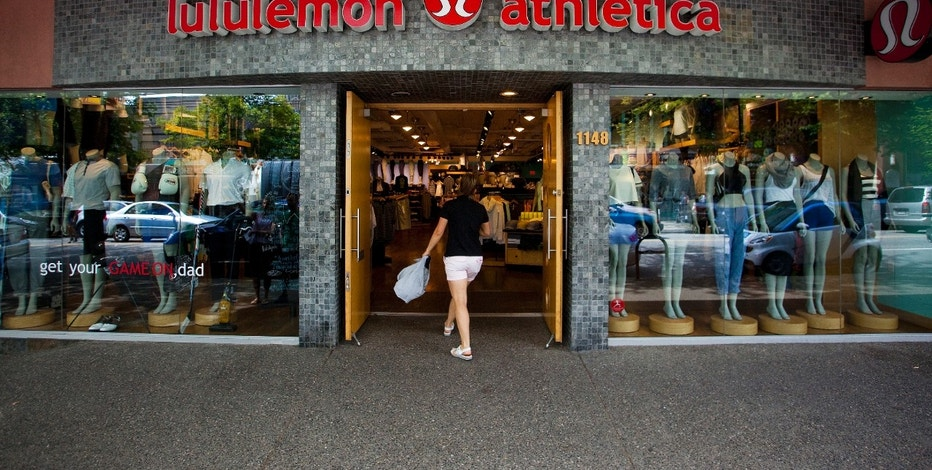 A woman walks into a store of yogawear retailer Lululemon Athletica in downtown Vancouver June 11, 2014. REUTERS/Ben Nelms (CANADA - Tags: BUSINESS LOGO) - RTR3TAH9