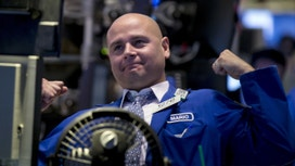 Dow Closes Above 18K for First Time Since July