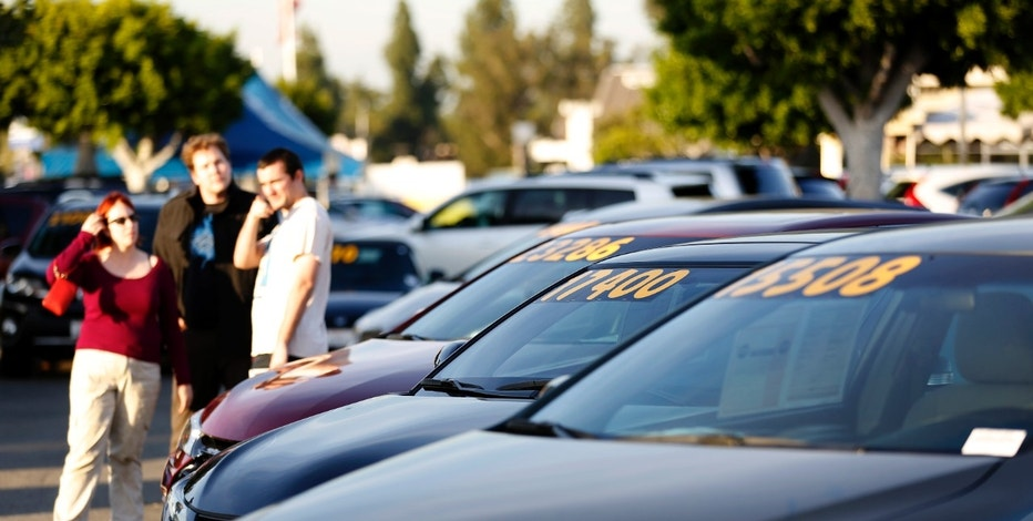 People look at vehicles for sale on the lot at AutoNation Toyota dealership in Cerritos, California December 9, 2015.