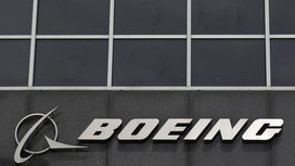 Boeing's 1Q Profit Hit by Tanker Charge
