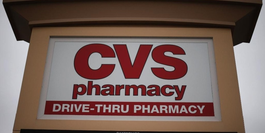 FILE - This March 17, 2014 file photo shows a CVS/Pharmacy in Dormont, Pa. CVS Health reports quarterly financial results on Tuesday, Aug. 4, 2015. (AP Photo/Gene J. Puskar, File)