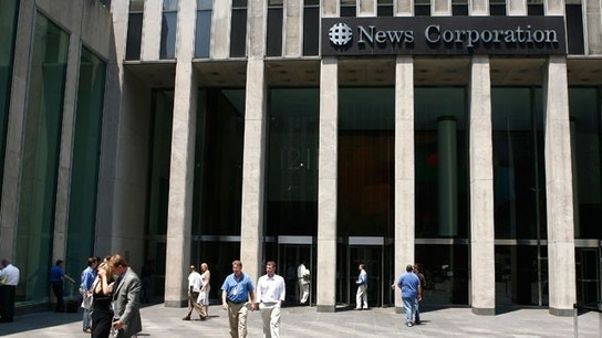 News Corp's Profit Hit By Charge