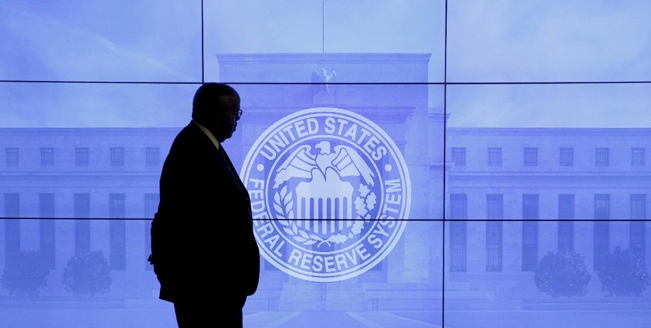 A security guard walks in front of an image of the Federal Reserve following the two-day Federal Open Market Committee (FOMC) policy meeting in Washington, March 16, 2016.  REUTERS/Kevin Lamarque/File Photo      TPX IMAGES OF THE DAY      - RTX2BXTD