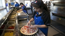 Domino's Sued for $500,000K Alleged Wage Theft by New York Franchisees