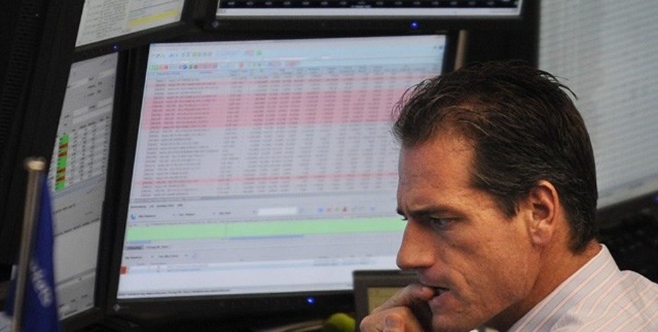 A share trader bites his fingernails as he follows the share price development on his monitors at the Frankfurt stock exchange, October 1, 2008.  REUTERS/Kai Pfaffenbach(GERMANY)