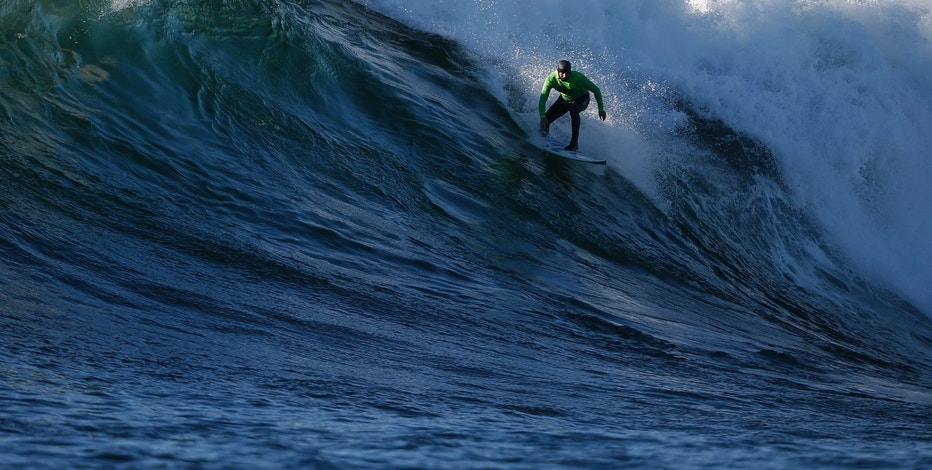 Shawn Dollar of the U.S. rides a wave during the final round of the Mavericks Invitational surfing competition in Half Moon Bay, California January 20, 2013. REUTERS/Stephen Lam (UNITED STATES - Tags: SPORT) - RTR3CPUD