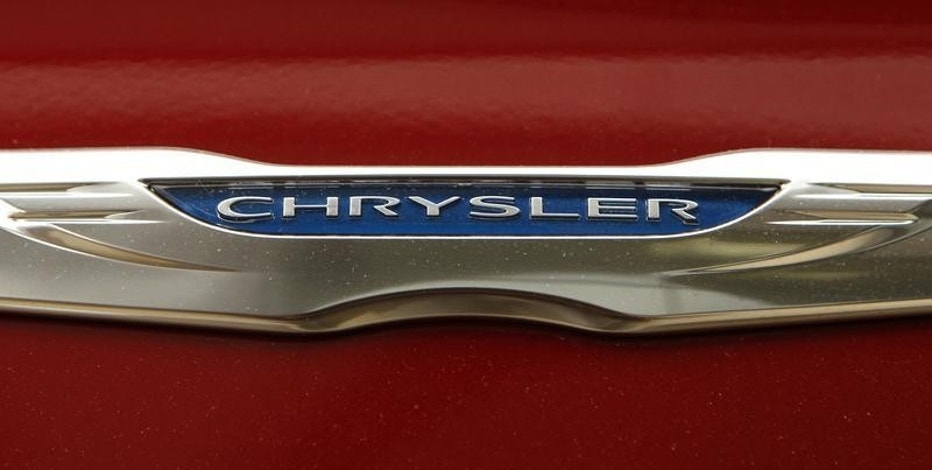 A Chrysler badge is pictured on a new car at a dealership in Vienna, Virginia April 26, 2012.