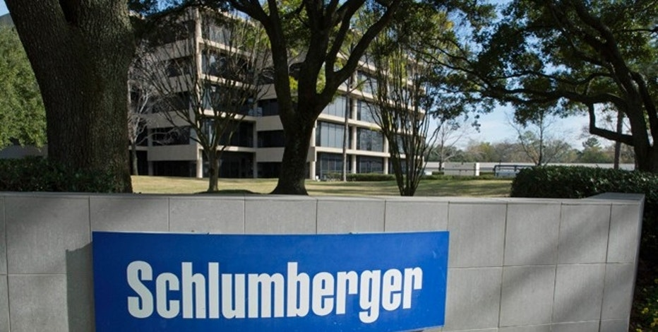 The exterior of a Schlumberger Corporation building is pictured in West Houston January 16, 2015. Schlumberger, the world's No.1 oilfield services provider, said it will cut 9,000 jobs, or about 7 percent of its workforce, as it focuses on controlling costs amid plummeting oil prices.   REUTERS/Richard Carson  (UNITED STATES - Tags: BUSINESS ENERGY EMPLOYMENT) - RTR4LQO3
