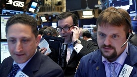 Wall St Falls on Disappointing Reports from Intel, Others