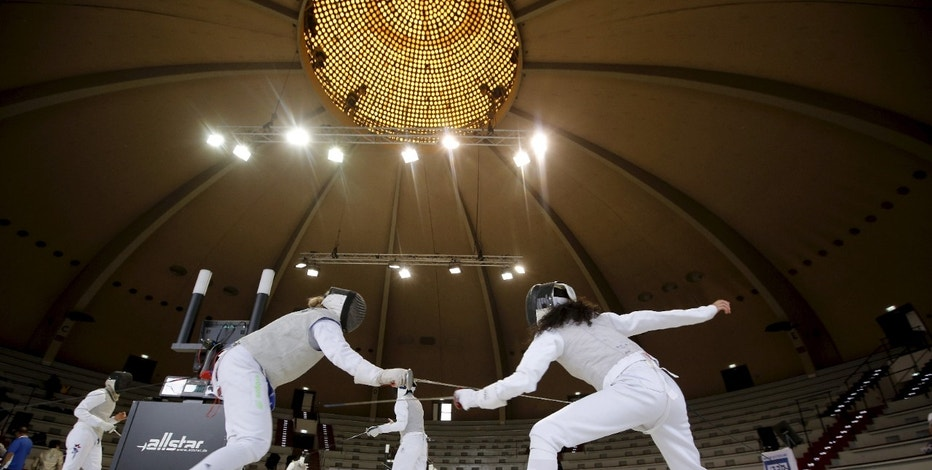 Competitors compete during the fencing competion during the 14th European Maccabi Games, inside the same venue used for the fencing competitons in the 1936 Summer Olympic Games at the Olympic park in Berlin, Germany July 29, 2015. Jewish athletes from dozens of nations will compete during the event, held in Germany for the first time in its history, according to the organisers. Seven decades after Adolf Hitler sought to stop Jews from competing in the 1936 Olympics in Berlin, more than 2,500 Jewish competitors will take part in the 14th European Maccabi Games from Wednesday at the same Olympic Stadium.       REUTERS/Fabrizio Bensch - RTX1M99F
