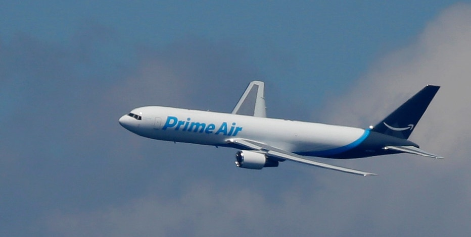 """A Boeing 767 with an Amazon.com """"Prime Air"""" livery flies over Lake Washington, Friday, Aug. 5, 2016, as part of the Boeing Seafair Air Show. Amazon unveiled its first branded cargo plane Thursday, one of 40 freighters that will make up the company's own air transportation network of 40 Boeing jets leased from Atlas Air and Air Transportation Services Group, which will operate the air cargo network."""
