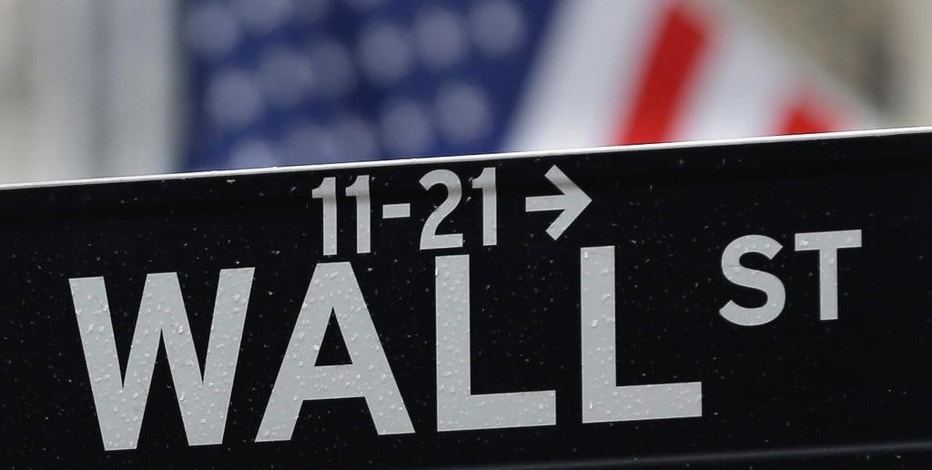 This July 9, 2015 photo shows a Wall Street sign near the New York Stock Exchange in New York.  World stock markets turned lower on Friday, Aug. 19, 2016 as investors speculated whether the U.S. Federal Reserve will raise interest rates in coming months. (AP Photo/Seth Wenig)