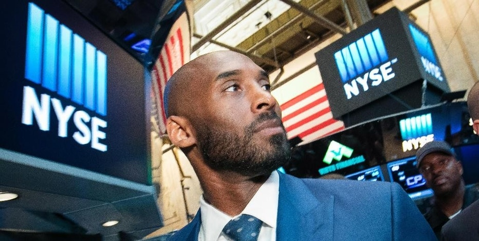 In this Monday, Aug. 22, 2016, photo provided by the New York Stock Exchange, retired NBA star Kobe Bryant visits the exchange, in New York. Bryant has partnered with Jeff Stibel, an entrepreneur and investor, to form the $100 million venture-capital firm Bryant Stibel, based in Los Angeles. (New York Stock Exchange via AP)