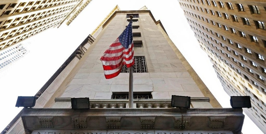 FILE - In this Friday, Nov. 13, 2015, file photo, the American flag flies above the Wall Street entrance to the New York Stock Exchange. Stocks were moving mostly lower in early trading Monday, Aug. 22, 2016, as investors looked ahead to the Fed's meeting in Jackson Hole, Wyo., for clues on timing for possible interest rate hikes. A drop in oil prices pulled energy companies lower, along with the broader market. (AP Photo/Richard Drew, File)