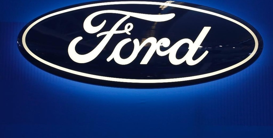 FILE - This Feb. 11, 2016, file photo shows the Ford logo on display at the Pittsburgh International Auto Show in Pittsburgh. Ford said Wednesday, Aug. 24, 2016, the company is recalling more than 88,000 cars and SUVs because the engines can stall without warning due to a fuel pump problem. The recall covers certain Ford Taurus and Police Interceptor sedans, Ford Flex wagons, Lincoln MKS sedans and Lincoln MKT SUVs from the 2013 through 2015 model years. (AP Photo/Gene J. Puskar, File)