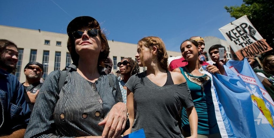 Actresses Susan Sarandon, left, joins a rally outside US District Court in Washington, Wednesday, Aug. 24, 2016, in solidarity with the Standing Rock Sioux Tribe in their lawsuit against the Army Corps of Engineers to protect their water and land from the Dakota Access Pipeline. A federal judge in Washington considered a request by the Standing Rock Sioux for a temporary injunction against an oil pipeline under construction near their reservation straddling the North Dakota-South Dakota border. (AP Photo/Manuel Balce Ceneta)