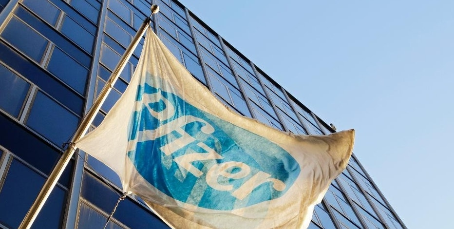 FILE - In this Monday, Nov. 23, 2015, file photo, the Pfizer flag flies in front of world headquarters in New York. On Wednesday, Aug. 24, 2016, drugmaker Pfizer said it's buying rights to Anglo-Swedish drugmaker AstraZeneca PLC's portfolio of approved and experimental antibiotic and antifungal pills, a move to boost Pfizer's business in one of its priority areas. The deal is valued in excess of $1.5 billion, including rights to sell the medicines in most countries outside the U.S., royalties and other payments. (AP Photo/Mark Lennihan, File)