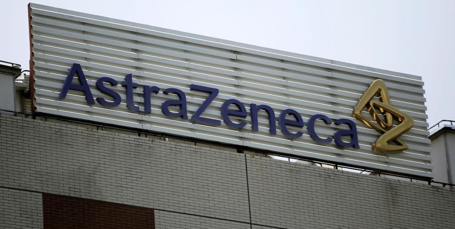 FILE - This July 24, 2013, file photo shows the AstraZeneca logo on the company's building in Shanghai, China. On Wednesday, Aug. 24, 2016, drugmaker Pfizer said it's buying rights to Anglo-Swedish drugmaker AstraZeneca PLC's portfolio of approved and experimental antibiotic and antifungal pills, a move to boost Pfizer's business in one of its priority areas. The deal is valued in excess of $1.5 billion, including rights to sell the medicines in most countries outside the U.S., royalties and other payments. (AP Photo/Eugene Hoshiko, File)