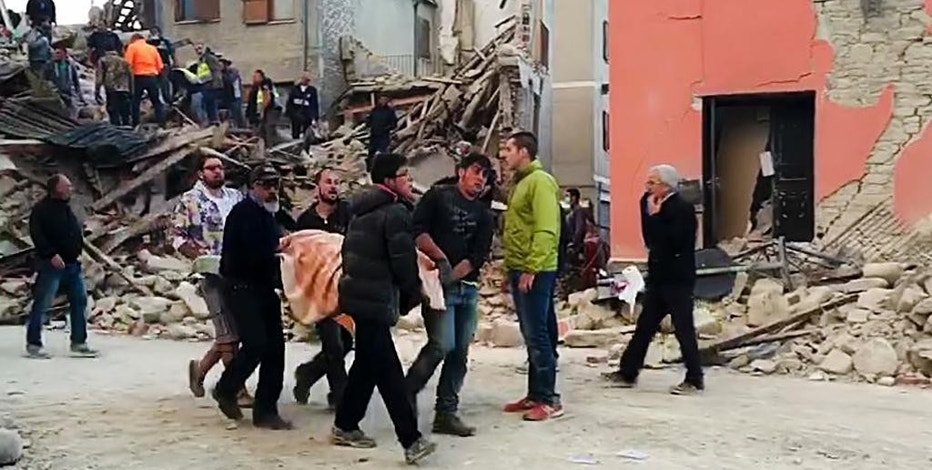 This still image taken from video shows rescuers recover a victim from a crumbled building in Amatrice, central Italy, where a 6.1 earthquake struck just after 3:30 a.m., Wednesday, Aug. 24, 2016. The quake was felt across a broad section of central Italy, including the capital Rome where people in homes in the historic center felt a long swaying followed by aftershocks. (AP Photo)