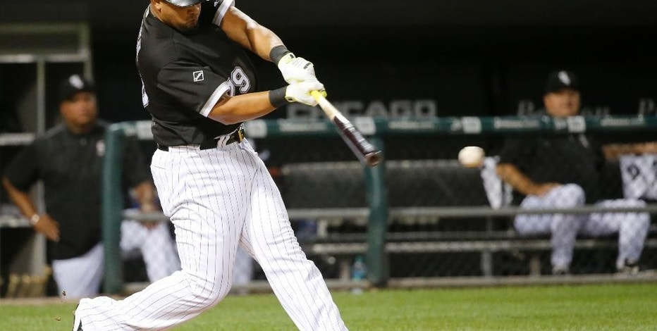 Chicago White Sox's Jose Abreu hits an RBI single off Philadelphia Phillies starting pitcher Jake Thompson, scoring Tim Anderson, during the third inning of an interleague baseball game Tuesday, Aug. 23, 2016, in Chicago. (AP Photo/Charles Rex Arbogast)