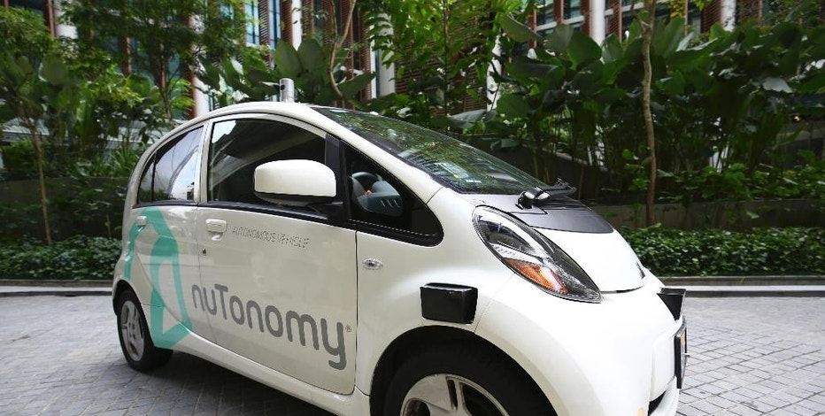 An autonomous vehicle is parked for its test drive in Singapore Wednesday, Aug. 24, 2016. The world's first self-driving taxis, operated by nuTonomy, an autonomous vehicle software startup, will be picking up passengers in Singapore starting Thursday, Aug. 25. The service will start small - six cars now, growing to a dozen by the end of the year. The ultimate goal, say nuTonomy officials, is to have a fully self-driving taxi fleet in Singapore by 2018, which will help sharply cut the number of cars on Singapore's congested roads. (AP Photo/Yong Teck Lim)
