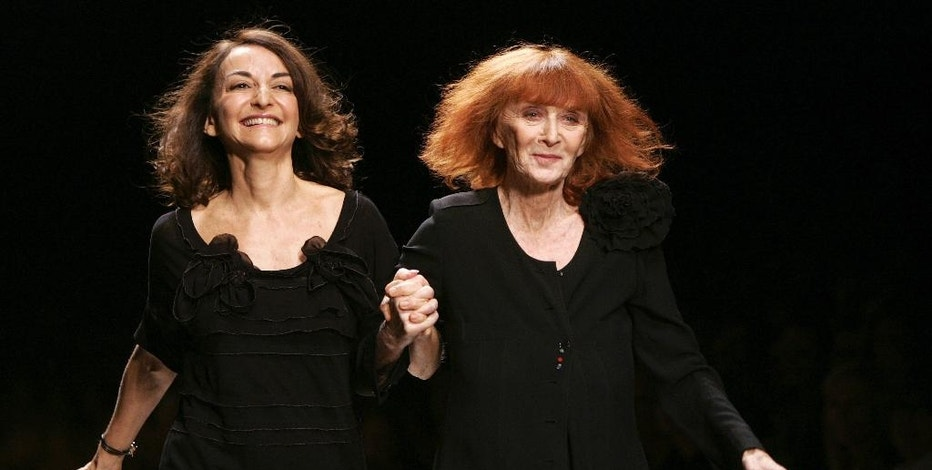 FILE - In this Oct.6, 2006 file photo, French fashion designers Sonia Rykiel, right, and her daughter Nathalie Rykiel acknowledge applause after the presentation of their Spring-summer 2007 ready-to-wear collection, in Paris. Rykiel, whose relaxed striped sweaters helped liberate women from their stuffy suits and who went on to run a global fashion empire, has died at 86, according to the French president's office. (AP Photo/Jacques Brinon, File)