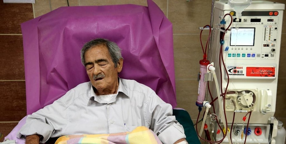 In this Saturday, Aug. 6, 2016 photo, Hassan Hamdampay uses a dialysis machine at a clinic in downtown Tehran, Iran. In Iran, a unique system allows those in need of a transplant to buy a kidney. The program, which has seen Iran's waitlist for kidneys effectively drop to zero, has been championed by some Western doctors as a way to cut time for lifesaving transplants. However, some ethicists worry about the system taking advantage of the poor worldwide to black-market organ sales. (AP Photo/Ebrahim Noroozi)