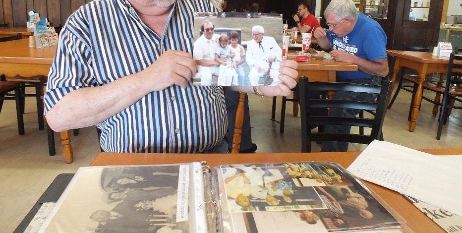 In this August 2016 photo, Joe Ledington, of Corbin, Ky., holds a 1980s photo of him with his uncle, Colonel Harland Sanders, who created his world-famous Kentucky Fried Chicken in his Corbin cafe. KFC says the recipe published in the Chicago Tribune is not authentic. But that hasn't stopped rampant online speculation that one of the most legendary and closely guarded secrets in the history of fast food has been exposed. (Jay Jones/Chicago Tribune via AP)