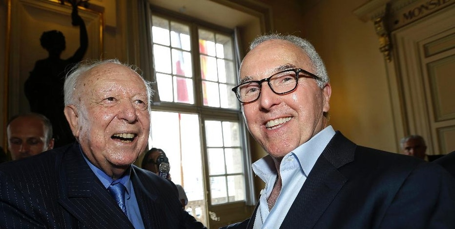 USA's Frank McCourt, right, former owner of the Los Angeles Dodgers, smiles with Marseille mayor Jean-Claude Gaudin, Monday, Aug. 29, 2016 in Marseille, southern France. Gaudin has announced that American businessman Frank McCourt, 63, has bought the popular football team, Olympique de Marseille. (AP Photo/Claude Paris)