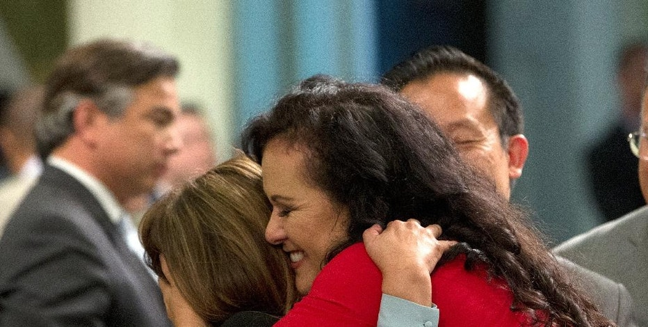 Assemblywoman Lorena Gonzalez, D-San Diego, right, receives congratulations from Assemblywoman Nora Campos, D-San Jose, after the Assembly approved her bill requiring farmworkers to receive overtime pay after working eight hours, at the Capitol, Monday, Aug. 29, 2016, in Sacramento, Calif. The measure, AB1066, now goes to the governor. (AP Photo/Rich Pedroncelli)
