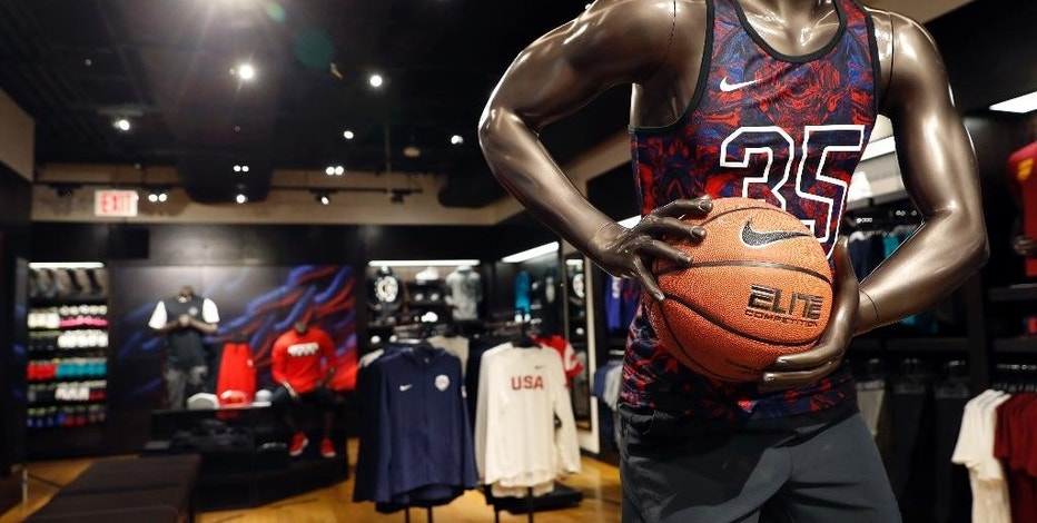 This Thursday, Aug. 25, 2016, photo, shows a display area in the House of Hoops shop at Foot Locker's redesigned Manhattan flagship store in New York. Foot Locker is reorganizing its stores to further highlight top brands, designating areas to showcase trends, and adding more displays of full sports gear to encourage broader shopping. (AP Photo/Mary Altaffer)