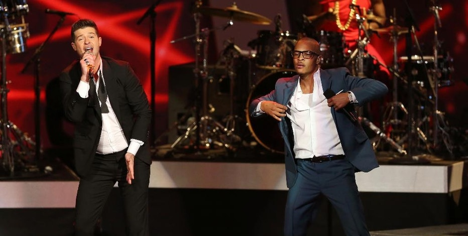 """FILE- In this Dec. 6, 2013, file photo, Robin Thicke, left, and T.I. perform """"Blurred Lines"""" at the Grammy Nominations Concert Live! at the Nokia Theatre L.A. Live in Los Angeles. More than 200 musicians filed a brief with the Ninth Circuit Court of Appeals on Tuesday, Aug. 30, 2016, to express concern about the ruling last year in a case brought by the children of Marvin Gaye, who sued for copyright infringement claiming """"Blurred Lines"""" copied Gaye's hit """"Got to Give it Up.""""  (Photo by Matt Sayles/Invision/AP, File)"""