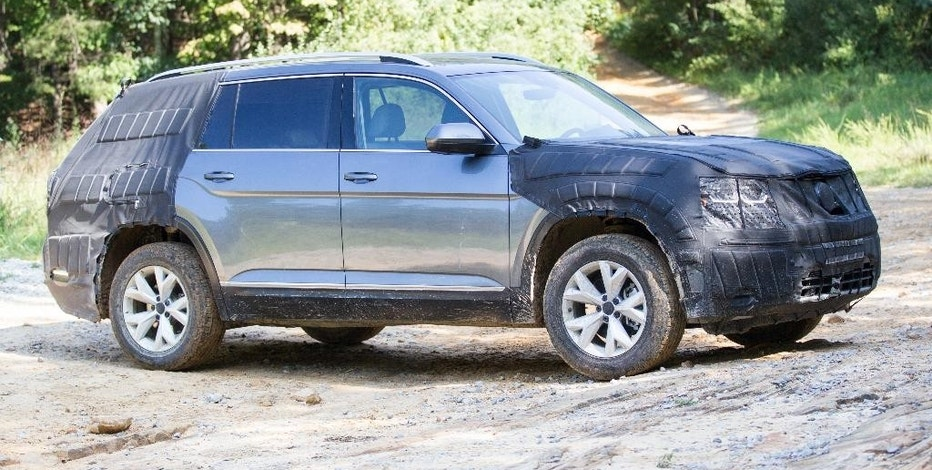 A camouflaged prototype of Volkswagen's new midsized SUV is seen on an off road trail at Prentice Cooper State Forest near Chattanooga, Tenn., Monday, Aug. 29, 2016. The German automaker plans to begin production of the new model at it Chattanooga plant later this year. (AP Photo/Erik Schelzig)