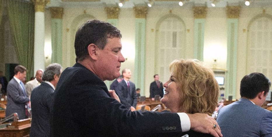 Republican lawmakers Don Wagner, of Irvine, and Shannon Grove, of Bakersfield, say goodbye after the Assembly adjourned at the end of their two-year legislative session in the early morning hours of Thursday, Sept. 1, 2016, in Sacramento, Calif. Both lawmakers are leaving the Assembly due to term limits. (AP Photo/Rich Pedroncelli)