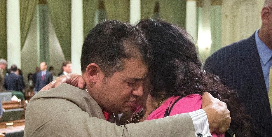 Assemblyman Das Williams, D-Santa Barbara, is hugged by Assemblywoman Lorena Gonzalez, D-San Diego after the assembly adjourned at the end of their two-year legislative session in the early morning hours of Thursday, Sept. 1, 2016, in Sacramento, Calif. Gonzalez is running for reelection in November, and Williams is leaving the Assembly due to term limits. (AP Photo/Rich Pedroncelli)