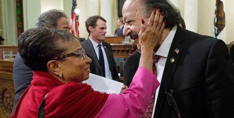 Assemblywoman Cheryl Brown, D-San Bernardino, and Assemblyman Katcho Achadjian, R-San Luis Obispo, say goodbye after the assembly adjourned at the end of their two-year legislative session in the early morning hours of Thursday, Sept. 1, 2016, in Sacramento, Calif. Brown is running for reelection in November, and Achadjian is leaving the Assembly due to term limits. (AP Photo/Rich Pedroncelli)