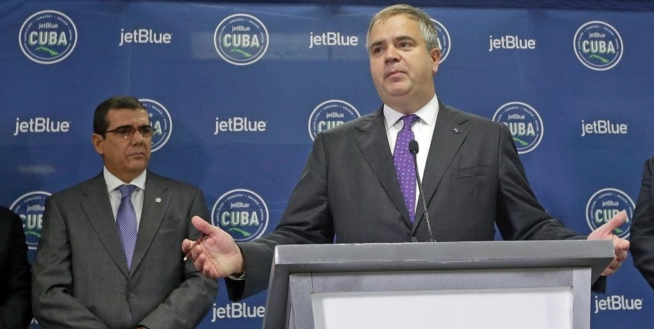 JetBlue President and Chief Executive Officer Robin Hayes speaks to reporters during a news conference as Cuban Ambassador to the United States Jose Cabanas, left, listens, Wednesday, Aug. 31, 2016, at the Fort Lauderdale-Hollywood International Airport in Fort Lauderdale, Fla. The first commercial flight, JetBlue 387,  between the United States and Cuba in more than a half century flew out of Fort Lauderdale for the central city of Santa Clara on Wednesday morning, re-establishing regular air service severed at the height of the Cold War. (AP Photo/Alan Diaz)