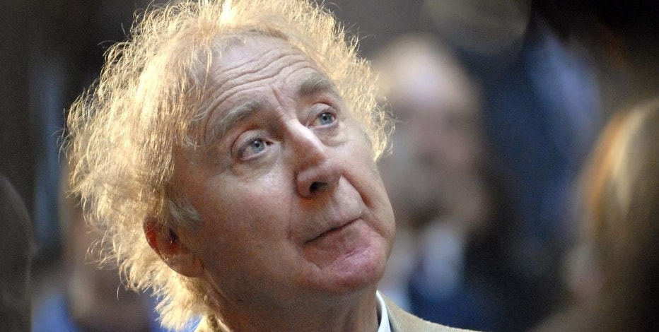 """FILE - In this April 9, 2008, file photo, actor Gene Wilder listens as he is introduced to receive the Governor's Awards for Excellence in Culture and Tourism at the Legislative Office Building in Hartford, Conn. AMC Theaters nationwide are bringing a few of Wilder's most beloved films back to theaters this weekend. Audiences can catch both """"Willy Wonka and the Chocolate Factory"""" and """"Blazing Saddles"""" this Saturday and Sunday evening at participating AMC locations, the theater chain announced Thursday, Sept. 1, 2016. (AP Photo/Jessica Hill, File)"""