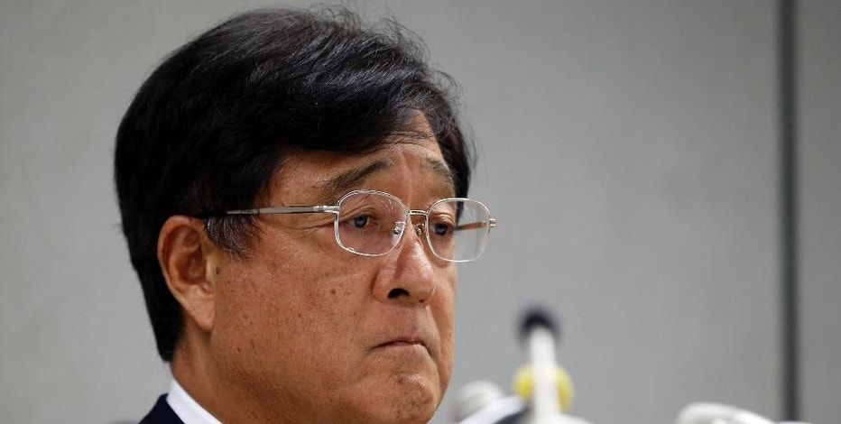FILE - In this Aug. 2, 2016 file photo, Mitsubishi Motors Corp. Chairman Osamu Masuko listens to a reporter's question during a press conference at the headquarters of the automaker in Tokyo. Japanese transport ministry officials raided the Tokyo headquarters of scandal-ridden Mitsubishi Motors Corp. Friday, Sept. 2, 2016 after the government alleged the automaker cheated on mileage ratings on more models than earlier reported. (AP Photo/Shizuo Kambayashi, File)