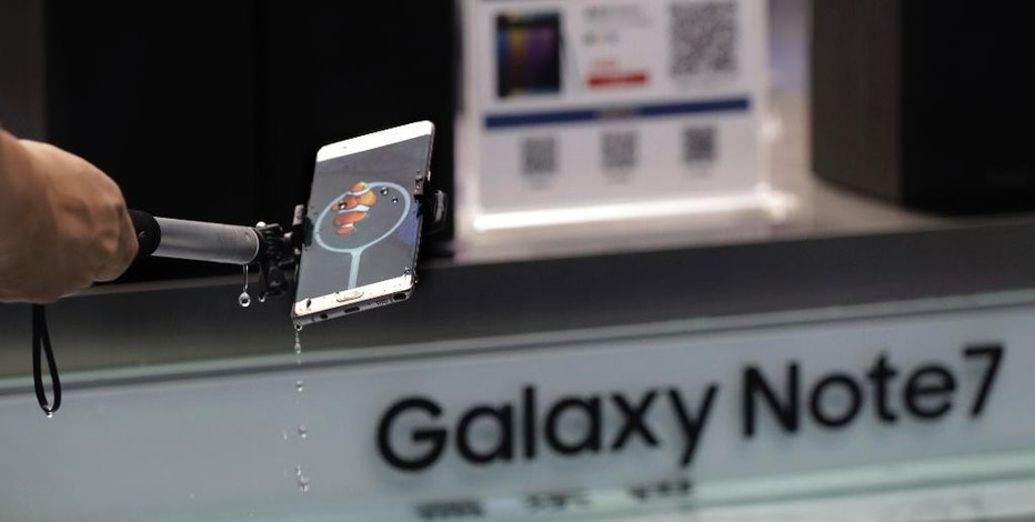 A man tries out the Samsung's latest smartphone Galaxy Note 7 at a roadshow booth outside a shopping mall in Beijing, Thursday, Sept. 1, 2016. Samsung has delayed shipments of Galaxy Note 7 smartphones in South Korea for quality control testing after reports that batteries in some of the jumbo smartphones exploded while they were being charged. (AP Photo/Andy Wong)