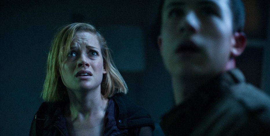 """FILE - This undated file image released by Sony Pictures shows Jane Levy, left, and Dylan Minnette in a scene from """"Dont Breathe."""" The horror thriller """"Don't Breathe"""" topped the box office for the second straight week, while a several new releases struggled to find any traction over the 2016 Labor Day weekend. (Gordon Timpen/Sony/Screen Gems via AP, File)"""