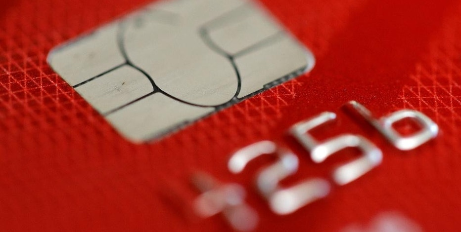 This Wednesday, June 10, 2015, photo shows a credit card in Philadelphia. Many colleges and universities let you pay with plastic, and some people do. But it can be a very poor financial decision that may cost you more in the long run. (AP Photo/Matt Rourke)