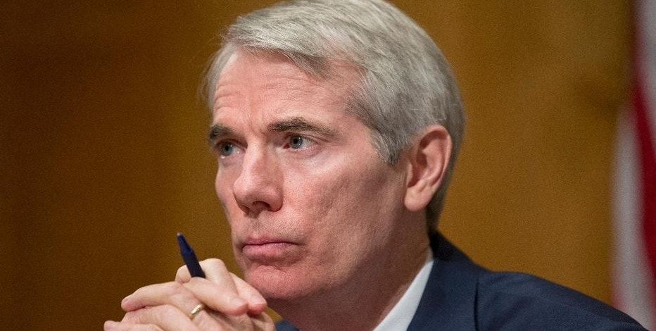 FILE - In this June 23, 2016 file photo, Sen. Rob Portman, R-Ohio listens during a hearing on Capitol Hill in Washington. An election-year bill that would protect health-care and pension benefits for more than 100,000 retired coal miners is dividing coal-state Republicans. Thousands of miners are expected to gather at the Capitol to push for the measure, which they describe as life-saving and fulfilling a promise the government made in 1946.  (AP Photo/Alex Brandon, File)