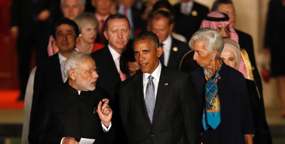 U.S. President Barack Obama, center, chats with Indian Prime Minister Narendra Modi, left, as they and other leaders arrive for a family photo at the Xizi hotel in Hangzhou in eastern China's Zhejiang province, Sunday, Sept. 4, 2016. (AP Photo/Ng Han Guan)