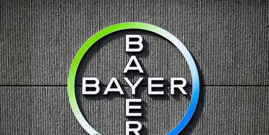 FILE - In this May 23, 2016 file picture the Bayer AG corporate logo is displayed on a building of the German drug and chemicals company in Berlin, Germany. German pharmaceutical giant Bayer AG says it's increasing its bid for American seed company Monsanto Co. The Leverkusen-based drug and chemicals company said in a statement early Tuesday  Sept. 6, 2016 it was offering US $127.50 per Monsanto share, up from the previous US $125 a share offer. Excluding debt of about US $9 billion, that values Monsanto at US $55.8 billion, about  US $1 billion more than the previous offer. (AP Photo/Markus Schreiber)