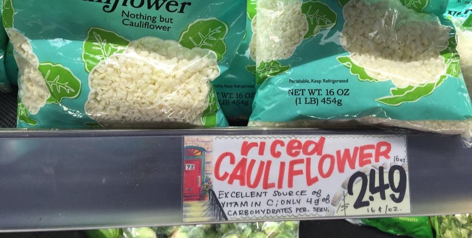 "This Thursday, Sept. 1, 2016, photo shows ""Riced Cauliflower"" for sale at a Trader Joe's in New York. Swapping out the rice and potatoes in dishes with chopped-up cauliflower gained traction with followers of the Paleo diet and others mindful of their carbs. Now, several companies are trying to take advantage of the trend. Trader Joe's began selling frozen ""Riced Cauliflower"" last year and a fresh version this year. (AP Photo/Candice Choi)"