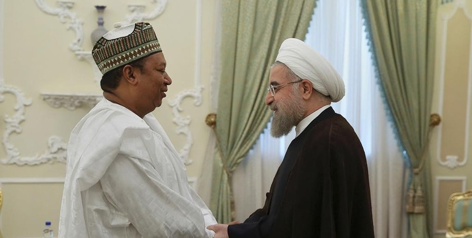 In this photo released by official website of the office of the Iranian Presidency, President Hassan Rouhani, right, welcomes Secretary General of OPEC Mohammad Sanusi Barkindo to their meeting in Tehran, Iran, Tuesday, Sept. 6, 2016. (Iranian Presidency Office via AP)